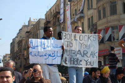 "<bdi class=""metadata-value"">2 men holding banners</bdi>"